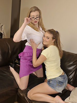 Busty blonde lesbians getting naughty on the couch