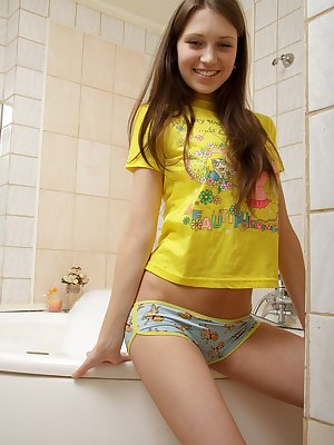 Sweet brunette babe fingering her lovely pussy in the bath