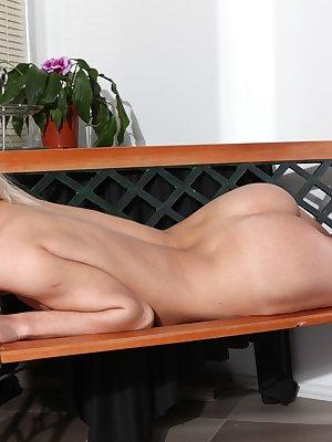 Sexy young blonde spreading her pussy on the couch