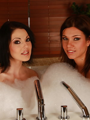 Two hot brunettes fucking with toys in the bath tub