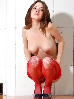 Sexy young babe spreading her pussy in red stockings