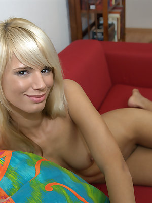 Sweet young blonde posing naked on the couch
