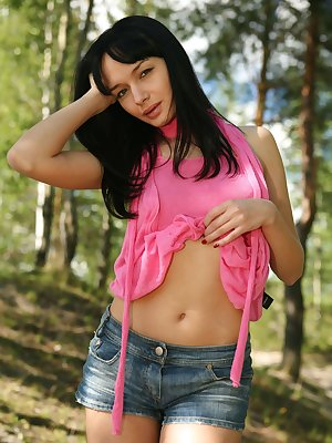 Cute young brunette shows pussy in the woods