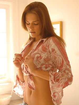 Pretty brunette babe removes panties in bedroom