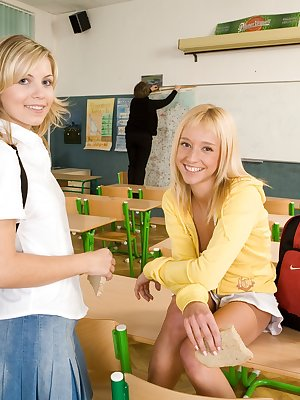 Two lesbian teens in the classroom after class