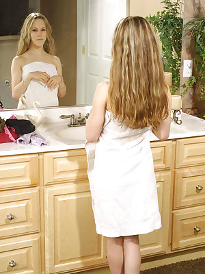 Stunning little blonde girl getting dressed