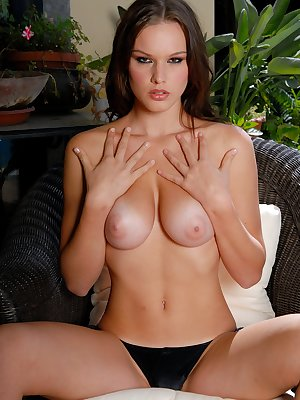 Showing off her sweet breasts for you