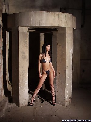 Sultry brunette in an industrial setting