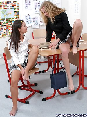 2 naughty girls get it on in the classroom