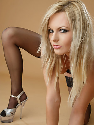 Cute blonde looks stunning in her black hold-ups