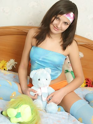 Sexy brunette plays with her toys