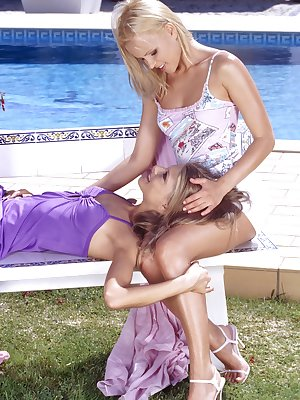 Naughty lesbo dildo action by the pool