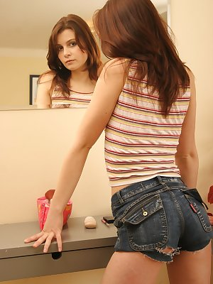 Awesome teen checks herself out in the mirror