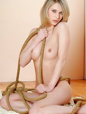 Lucious Lucie gets naked and horny with ropes