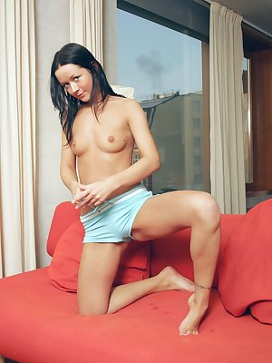 Sexy brunette Laura shows off her perfect little ass