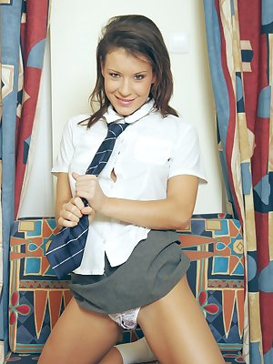 Naughty wannabe schoolgirl plays up on the couch