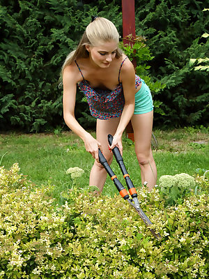 Petite Euro babe Cayenne trims the hedges before tending her own flower with the handle to her shears and getting into DP play with a vibrator and large glass dildo