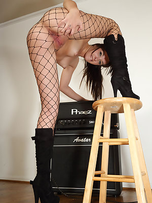 Natalie Heart puts on an amped up performance in sexy fishnet stockings and boots, then jerks her talent scout off by hand all over her small, perky tits