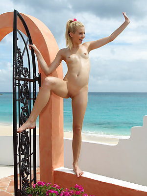 Franziska poses in a fishnet bikini, the warm, Carbbean sun glistening off the lean curves off her petite body and tiny tits, she then mounts the villa wall to spray her golden showers