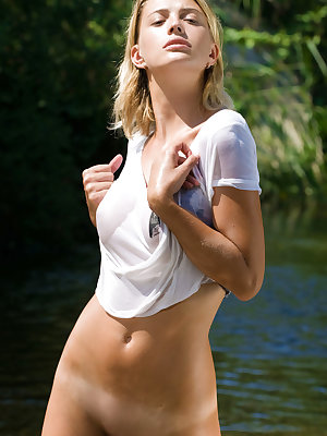 Vika R shows off her gorgeous, wet body as she poses at the river.