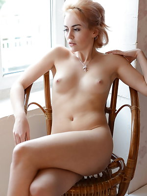 Alluring blonde Monroe flaunts her soft, creamy body as she poses by the window.