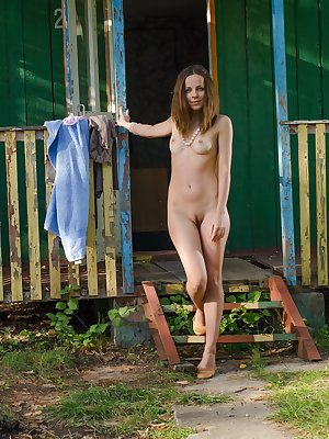 Newcomer Leana A shows off her slim body and small tits outside the house.