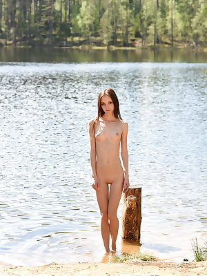 Pala strips in the forest baring her petite body.