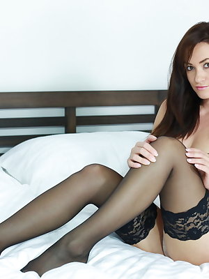 Tess Lyndon strips her sexy lingerie baring her luscious body on the bed.