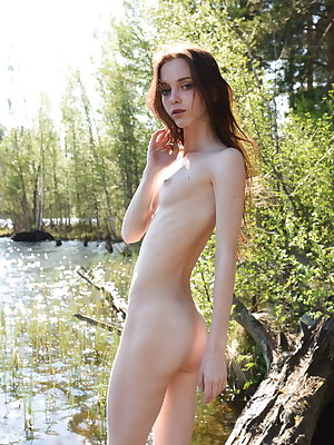 Pala strips by the river as she displays her petite body.