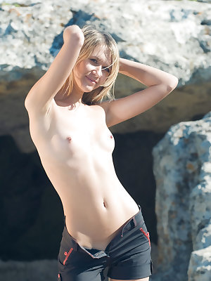 Viki D strips outdoors as she displays her petite body.