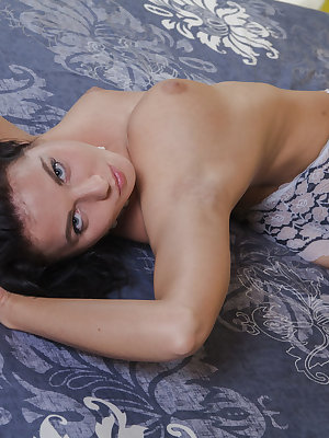 Newcomer Tara C shows off her gorgeous tits and delectable pussy on the bed.