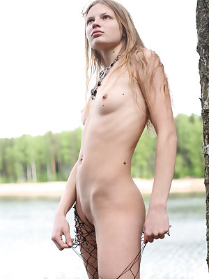 Lyubov flaunts her petite body as she poses at the riverside.