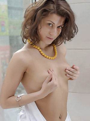 Newcomer Mixaella flaunts her small tits and delectable pussy by the window.