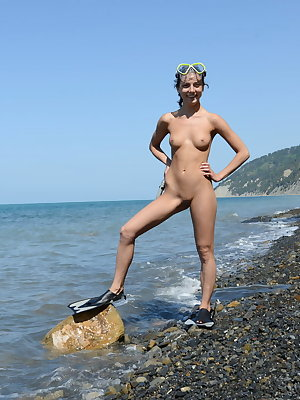 Katoa bares her nubile body as she playfully dips in the beach.