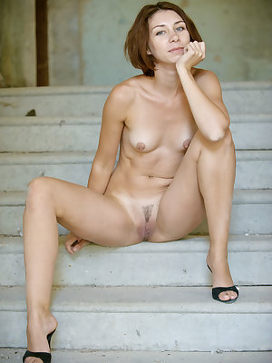 Oda delightfully poses by the stairs as she flaunts her petite body with erect nipples.