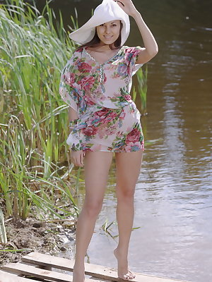 Sila delightfully poses by the river as she bares her slender, sexy body and   tight butt.