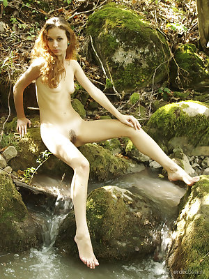 Newcomer Lu Novia bares her lean, petite body and hairy pussy as she sensually   poses in the forest.
