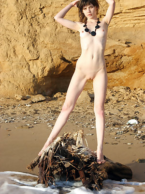 Lusi flaunts her petite body with pink nipples as she poses by the beach.