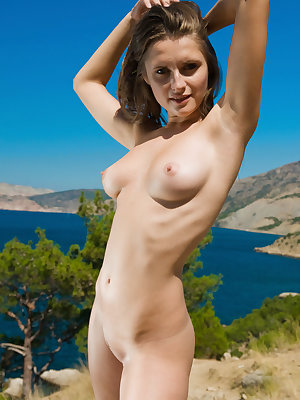 Newcomer Kaz bares her slender body with large tits as she playfully poses in the outdoors.