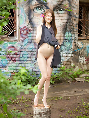 Newcomer Lela strips her dress baring her creamy, slender body as she poses by the brick   wall.