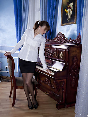 Mariara strips by the piano as she bares her delectable body and yummy pussy.