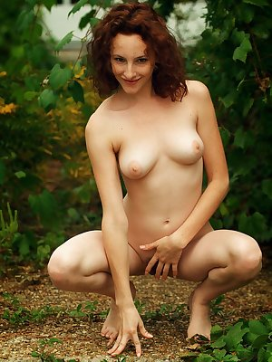 Newcomer Taneka playfully poses in the outdoors as she shows off her nubile body   and unshaven pussy.