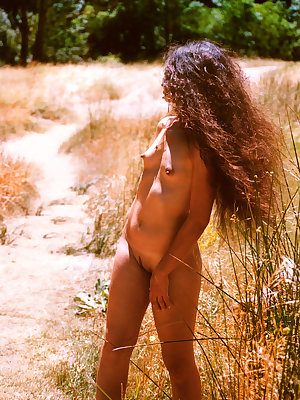 Idoia A sensually poses under the afternoon sun baring her petite body with small   breasts.