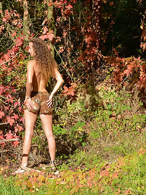 Curyl-haired Sarka displays her slender body with beautiful tits and meaty butt   as she playfully poses in the forest.
