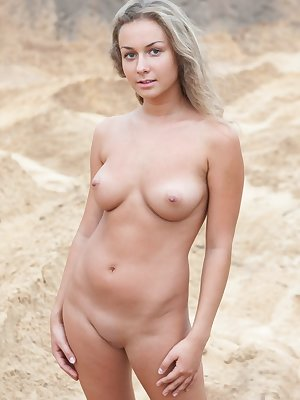 Chiara M flaunts her luscious body with beautiful breasts as she playfully  poses on the sandy beach.