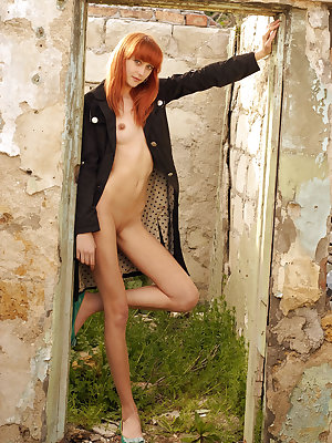 Newcomer Verika A strips her blue lingerie baring her lean, petite body as she   poses sensually in the outdoors.