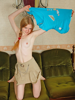 Avril A strips and bares her lean, petite body and delectable   assets as she poses on the couch.