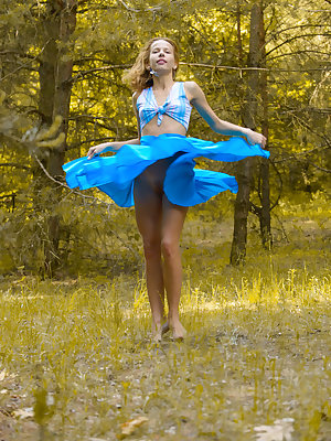New model Ovta flaunts her petite and lean body with small perky breasts as she   delightfully poses in the outdoors.