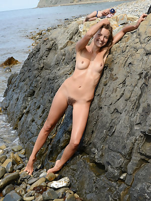 New model Geissa playfully poses at the rocky shores by the beach.