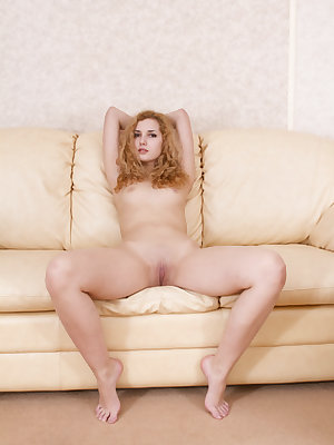 Beautiful Tofana A flaunts her naked body and tight ass on the couch.